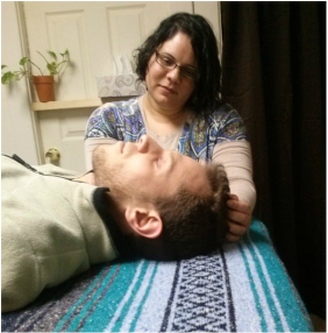 Shira Oz-Sinai treating a client with Soul Lightening Acupressure